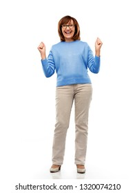 success and old people concept - portrait of happy laughing senior woman in glasses celebrating triumph over white background