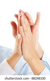 Success, partnership and teamwork concept. Hands of a successful business team on a white background