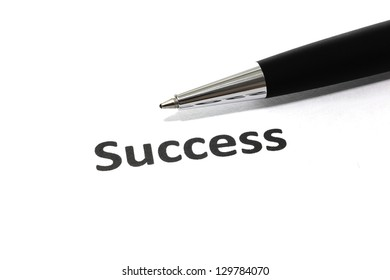 Success with pen isolated close-up