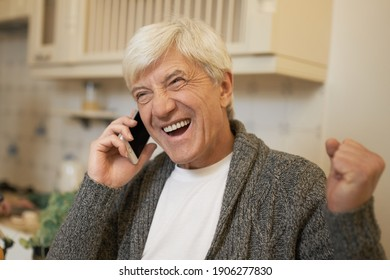 Success, positive emotions, excitement and technology. Headshot of happy gray haired man exclaiming, clenching fists, having excited facial expression while receiving good news, speaking on cell phone