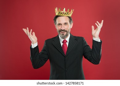 Success rewarded his efforts. Mature man wearing crown jewel on red background. Successful businessman enjoying success and big time. Motivation of success. Achieving success and triumph.