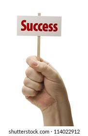 Success Sign In Male Fist Isolated On A White Background.