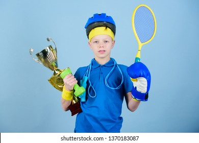 Success in sport. Proud of achieved success. Succeed in everything. Athlete successful boy sport equipment jump rope boxing glove tennis racket roller skate and golden goblet. Success and award.
