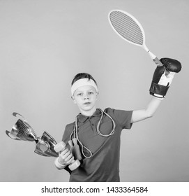 Success in sport. Succeed in everything. Athlete successful boy sport equipment jump rope boxing glove tennis racket roller skate and golden goblet. Success and award. Proud of achieved success.