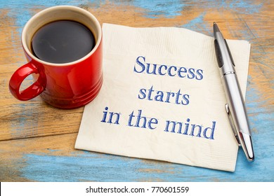 Success starts in the mind - inspirational handwriting on a napkin with a cup of coffee