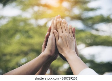 Success Teamwork Together high five on air greeting  power of tag team. Group of diversity people multiethnic  unity togetherness in Volunteer community. Collaboration Business Team success concept.