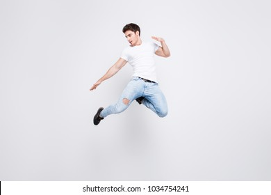 Success win winner achievement goal lifestyle leisure sexy people person cool swag people person concept. Full-length full-size portrait of attractive muscular guy jumping up isolated gray background