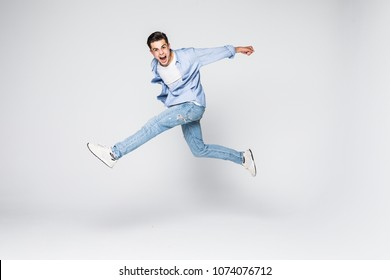 Success win winner achievement goal lifestyle leisure sexy people person cool swag people person concept. Full-length full-size portrait of attractive muscular guy jumping up