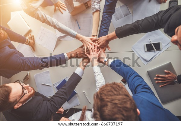 success and winning concept - happy business team celebrating victory in office