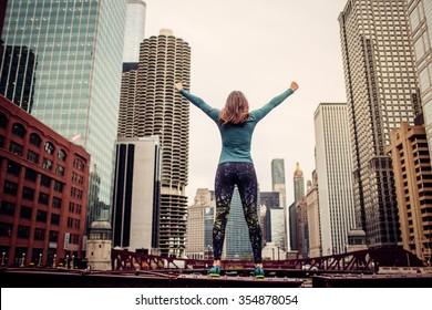 Success. woman standing on the bridge.Skyscraper