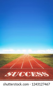 success word on running track and sky background