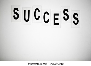 Success word written on white table. Copy space