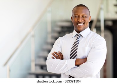 successful african office worker with arms crossed