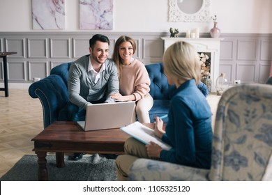 Successful agent giving consultation to family couple about buying house. Consultation.