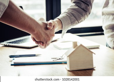 Successful agreement , estate,home buying contract concept, buyer shaking hand with bank empoyees after finishing signing contract in office