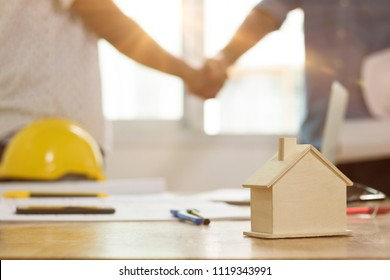 Successful agreement , estate,home buying contract concept, engineer shaking hand with investor after finishing signing contract in office