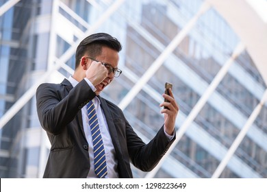 Successful Asian businessman is exiting positive body language.