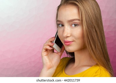 successful and beautiful business woman with the  phone