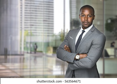 Successful black business man ceo downtown workspace proud confident arms crossed