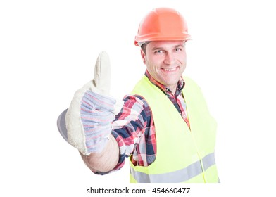Successful builder smiling and showing thumb up gesture isolated on white background
