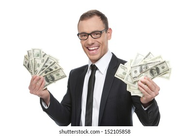 Successful buinessman. Happy young man in formalwear and glasses holding money while standing isolated on white