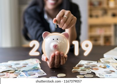 Successful business in 2019.Start new year business goal.Money saving piggy bank for deposit salary and profit income,hands holding piggy bank.