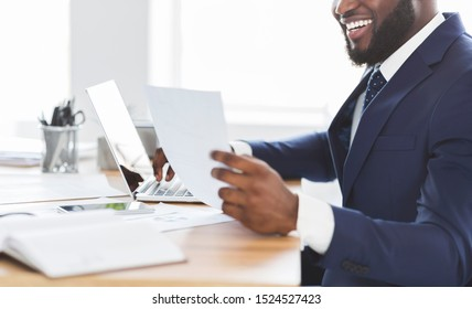 Successful business concept. Happy black man reading marketing research results, cropped, free space