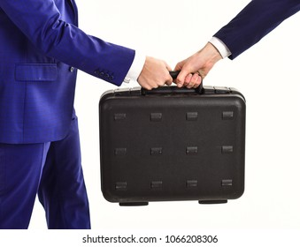 Successful business deal concept. Male hands in suits hold black briefcase. Male hands carry briefcase for exchange. Handover of case in hands of business partners, isolated on white background.