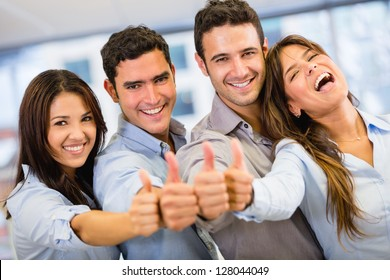 Successful business group with thumbs up at the office