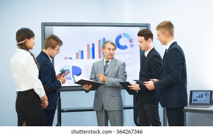 successful business man, conducting presentations to partners