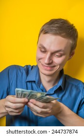 Successful business man counting money - isolated over white