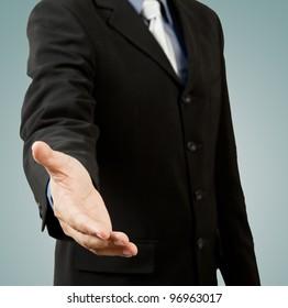 successful business man, gesturing handshake or help