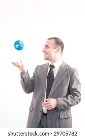 Successful business man with globe over a white background