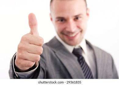 Successful business man looking happy over a white background