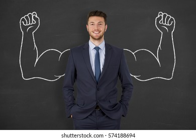 Successful business man on blackboard