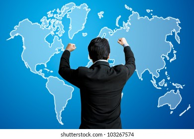 Successful business man raising hand in front of virtual world map screen