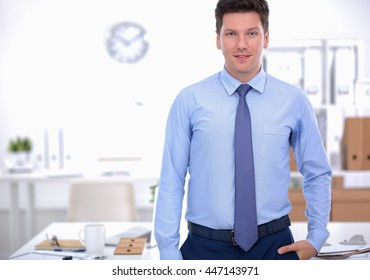 Successful business man standing in office
