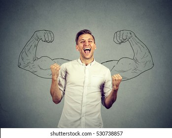 Successful business man winning fists pumped celebrating success flexing muscles isolated gray wall background. Positive human emotion facial expression. Life perception