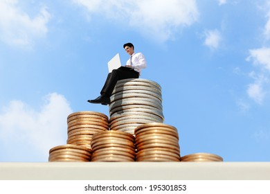 Successful business man working on growth money stairs coin with sky