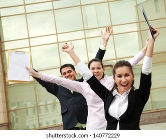 Successful business people with arms up and screaming