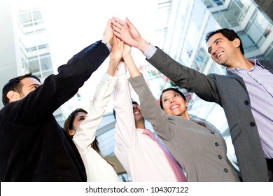Successful business people celebrating with a high-five