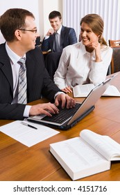 Successful business people discuss the marketing plan in a work environment