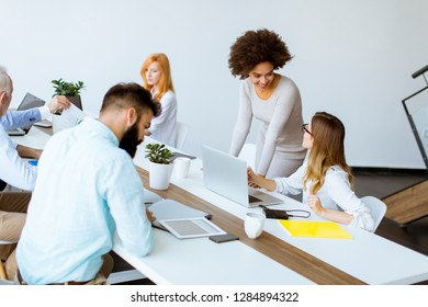 Successful  business people discussing documents and working in modern office