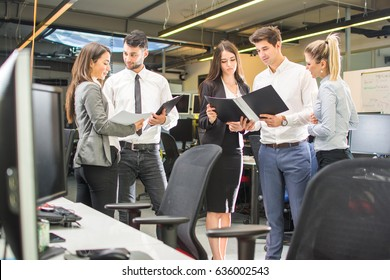 Successful business people working with documents at the office. Group of businesspeople working together in office.