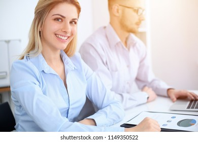 Successful business people working at meeting in office