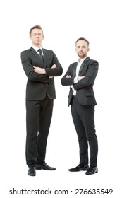 Successful business tandem. Full length of two confident businessmen in formal wear standing close to each other. Isolated on white.