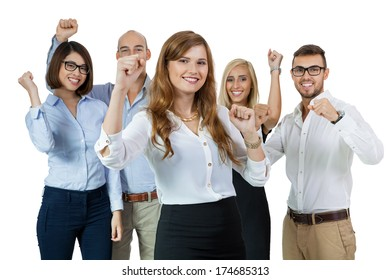 Successful business team of diverse young executives standing cheering and celebrating their success with an attractive young businesswoman or team leader in the foreground, on white