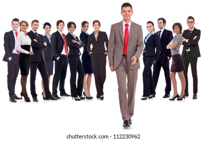 successful business team with a business man walking forward leading it - be different concept - isolated over a white background