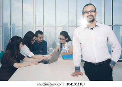 Successful business team with manager in a meeting room