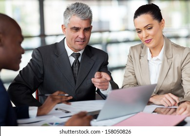 successful business team planning work on laptop